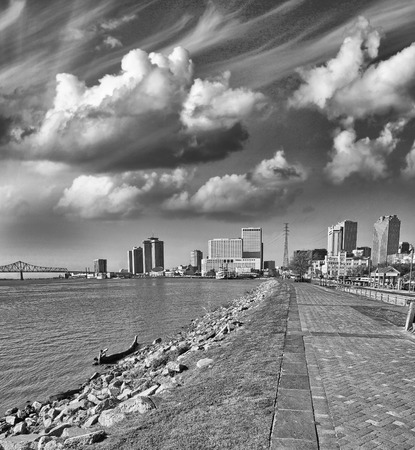 New Orleans, Lousiana. Mississippi waterfront with walkway and city buildings. photo