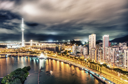 Macau, China. Aerial view of city buildings and tower at night. Reklamní fotografie