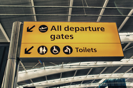 All departure gates and Toilets sign in the airport. photo