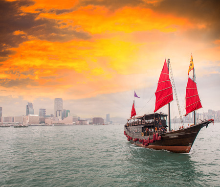 Famous Red Sails Ship crossing the strait from Hong Kong to Kowloon. photo