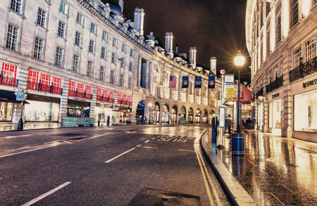 regent: LONDON - SEP 29, 2013: Regent street architecture at night. It was named after Prince Regent, completed in 1825. Every building in Regent Street is protected as a Listed Building Editorial