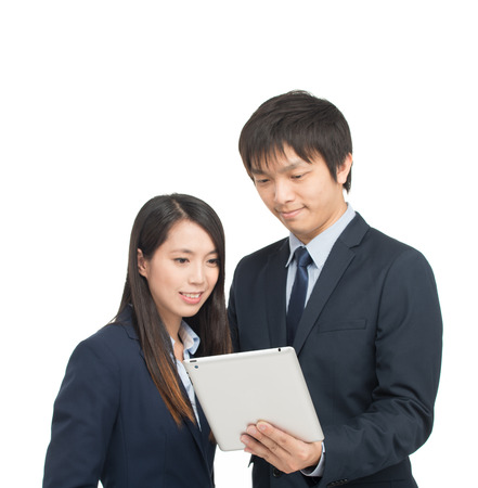 Asian businessman and businesswoman using tablet computer analyzing results. Isolated on white. photo