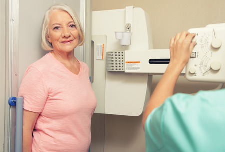 Woman patient ready to be scanned at X-Ray machine. photo