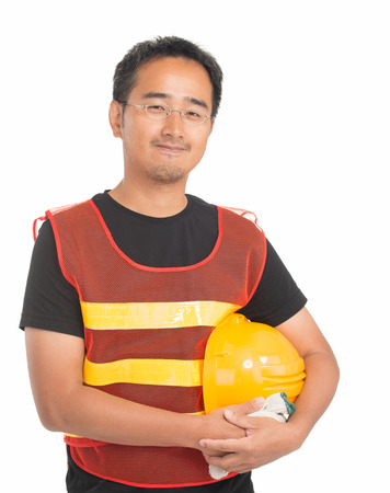 Young asian worker with safety vest and helmet. Isolated on white. photo