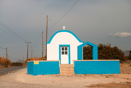 Classic blue and white chapel in Greece. Stock Photo