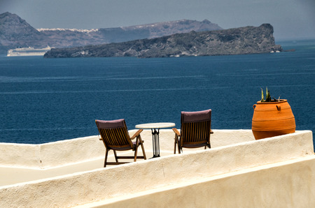 Deckchairs of a wonderful island terrace. photo