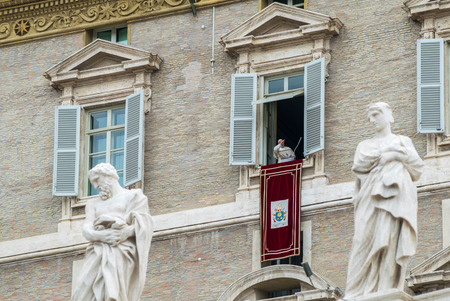 francesco: ROME, ITALY - JUNE 1, 2014: Pope Francis greets faithful in St. Peters Square from his window at Basilica di San Pietro in Rome Italy.