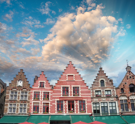 Colorful square and houses in Bruges, Belgium. photo