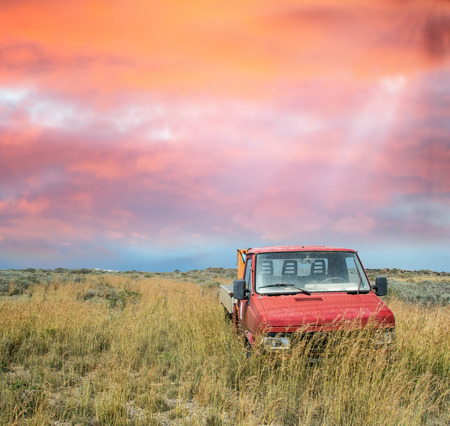 Abandoned truck on a meadow. photo