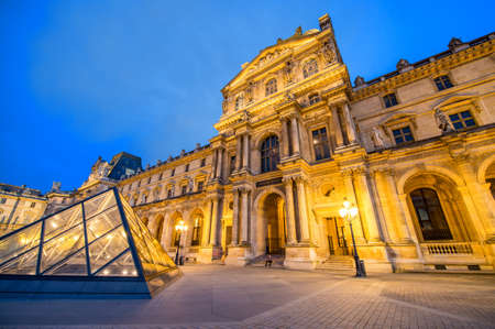 million: PARIS - JUN 22: Louvre museum at twilight in summer on June 22, 2014. Louvre museum is one of the worlds largest museums with more than 8 million visitors each year Editorial