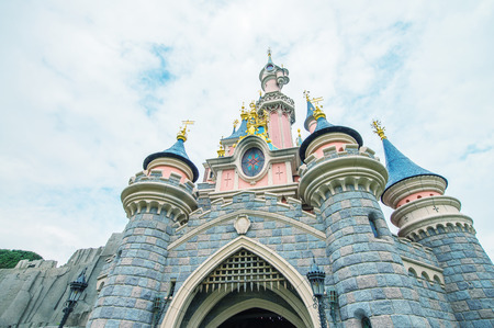 mickey: PARIS - JUNE 16, 2014: Castle of Disneyland Park in Paris, France. Disneyland is the most visited attraction in all of France and Europe. Editorial