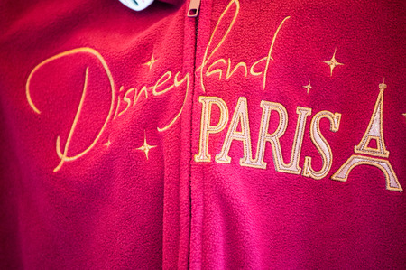 PARIS - JUNE 16, 2014: Commemorative sweatshirt of Disneyland Park in Paris, France. Disneyland is the most visited attraction in all of France and Europe.