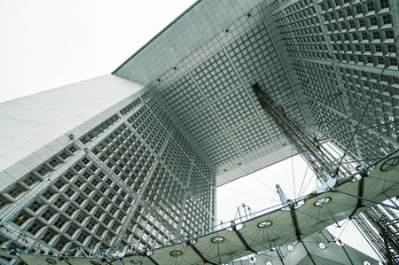 disctrict: PARIS - JUNE 17, 2014: Powerful structure of Grand Arche in La Defense financial disctrict. La Grande Arche is 110m high and was inaugurated in July 1989.