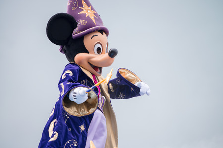 mickey: PARIS - JUNE 16, 2014: Disney Characters Parade in Disneyland Park, Paris, France. Disneyland is the most visited attraction in all of France and Europe. Editorial