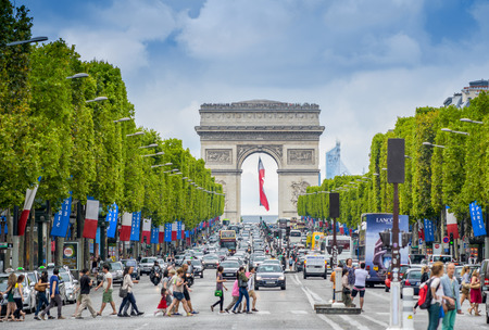champs elysees: PARIS - JULY 20, 2014: Tourists on the famous Champs Elysees Avenue. With its cafes and luxury shops the Champs Elysees is one of the worlds most famous streets.