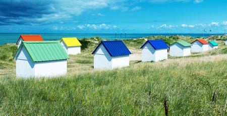 coastline: Colourful homes on a beautiful ocean coastline. Stock Photo