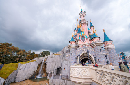 PARIS - JUNE 16, 2014: Castle of Disneyland Park in Paris, France. Disneyland is the most visited attraction in all of France and Europe.