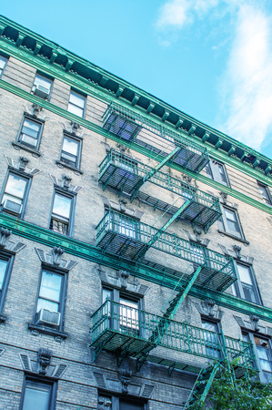 bowery: Classic New York Bowery building with green ladders for fire escape.
