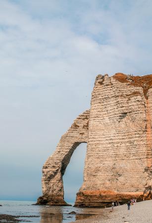 Etretat,Normandy. La Manneporte natural rock arch wonder, cliff and beach photo