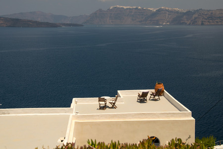 Deckchairs of a wonderful island terrace. photo