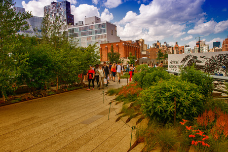 chelsea: NEW YORK - JUNE 15, 2013: The High Line Park in New York with locals and tourists. The High Line is a popular linear park built on the elevated train tracks above Tenth Ave in New York City Editorial