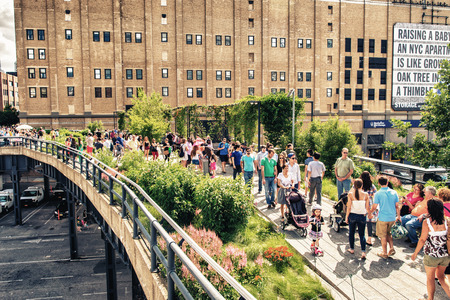 NEW YORK - JUNE 15, 2013: The High Line Park in New York with locals and tourists. The High Line is a popular linear park built on the elevated train tracks above Tenth Ave in New York City Editorial