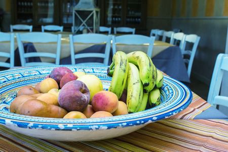 Tray of fresh fruits on the table. photo
