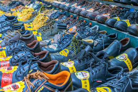 sidewalk sale: HONG KONG, APRIL 10: Market sale of shoes on the sidewalk road in Sham Shui Po, on April 10, 2014. Government now stop provide any new certification for concession stand for image of the city.