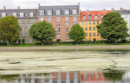 COPENHAGEN - JUNE 28, 2007: Locals and tourists enjoy city life. About five million people visit the city every year