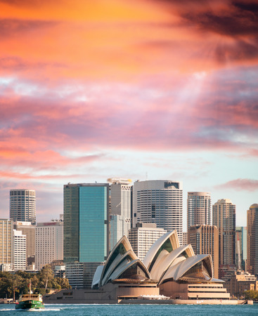 SYDNEY, AUSTRALIA - JUL 27, 2010: City skyline at sunset. The city is visited by more than 15 million people every year.