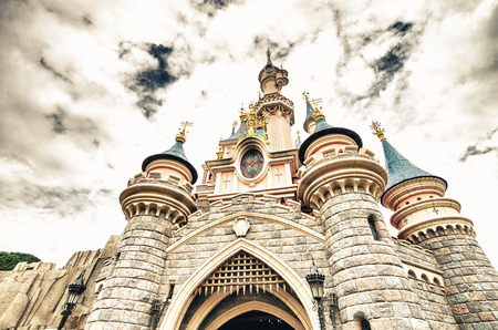 PARIS - JUNE 16, 2014: Castle of Disneyland Park in Paris, France. Disneyland is the most visited attraction in all of France and Europe. Editorial