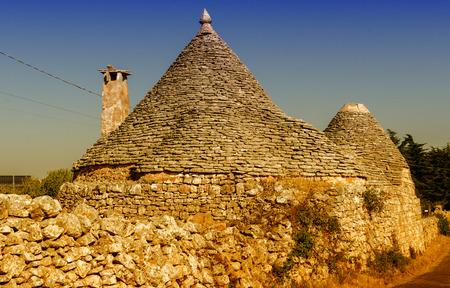 trulli: Apulia, Italy. Unique Trulli houses with conical roofs in Alberobello - Puglia, Italia.
