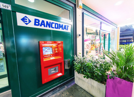 bancomat: RICCIONE, ITALY - SEPTEMBER 7, 2014: ATM machine on a city street. More and more people in Italy are using bancomat service, which is located everywhere in the cities.