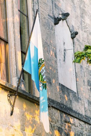marino: Flag of San Marino out of a medieval building. Stock Photo