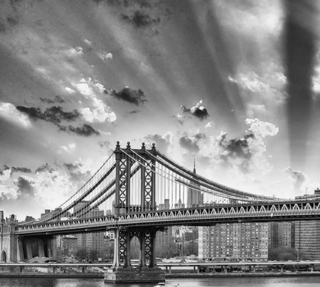 New York. Manhattan Bridge and city skyine at dusk. photo