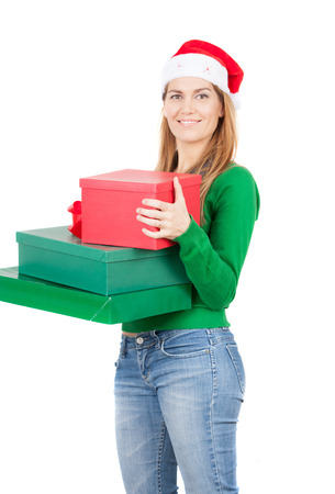 santa helper: Cheerful santa helper girl with gift boxes. Isolated on white.