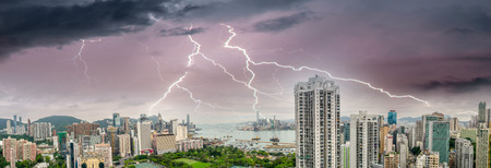 hosted: HONG KONG - MAY 12, 2014: Stunning panoramic view of Hong Kong Island and Kowloon on a cloudy day. Last year HK hosted more than 54 million visitors, most of them from the mainland.