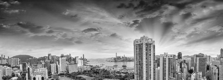 HONG KONG - MAY 12, 2014: Stunning panoramic view of Hong Kong Island and Kowloon on a cloudy day. Last year HK hosted more than 54 million visitors, most of them from the mainland. photo