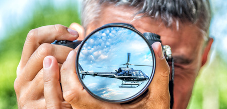 blackhawk helicopter: Photographer taking photo with DSLR camera at Helicopter. Shallow DOF Stock Photo