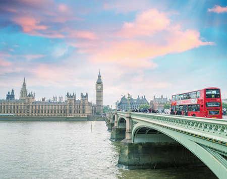 London, England. Double Decker bus crossing Westminster Bridge. photo