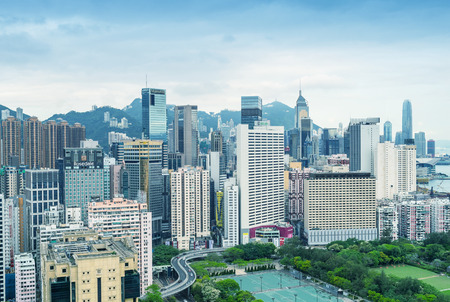 each year: HONG KONG - MAY 5, 2014: Skyline of Hong Kong on a spring day. The city is a major tourist attraction with more than 30 million visitors each year.