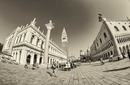 saint mark square: VENICE - APRIL 7, 2014: Tourists enjoy Saint Mark Square on a beautiful spring day. Venice is visted by more than 20 million people every year.