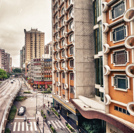 purchasing power: MACAU - MAY 10, 2014: Buildings of Macau on a cloudy day. Macau is one of the worlds richest cities, with the highest GDP per capita by purchasing power parity as of 2013.