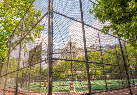 kickball: NEW YORK - JUNE 15, 2013: Chelsea Park sport field in Manhattan. The park has track, soccer field that doubles as a football and softball and kickball field.