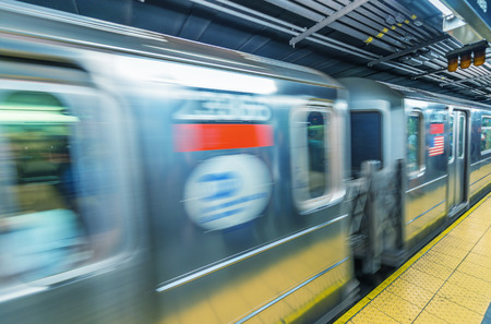 Fast moving train in Manhattan subway - New York transportation concept.