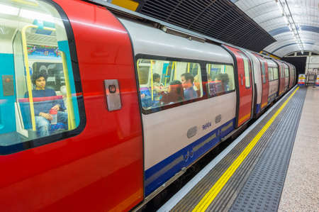 kilometres: LONDON - SEPTEMBER 28, 2013: Subway train in underground station. London subway system serves 270 stations and has 402 kilometres (250 mi) of track.