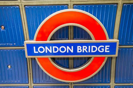 kilometres: LONDON - SEPTEMBER 28, 2013: London Bridge underground sign. London subway system serves 270 stations and has 402 kilometres (250 mi) of track Editorial