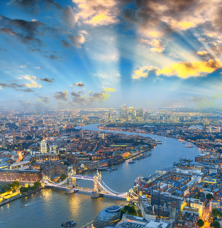 aerial: London at night. Aerial view of Tower Bridge area and city lights. Stock Photo