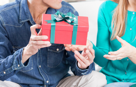 exchanging: Exchanging gifts for Christmas. Holiday concept.