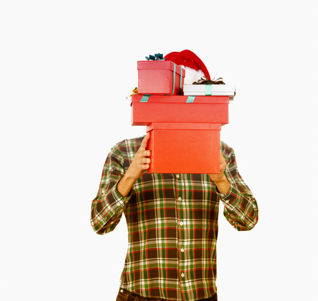 face covered: Santa with covered face handing Christmas gifts. Isolated on white background. Holiday concept. Stock Photo